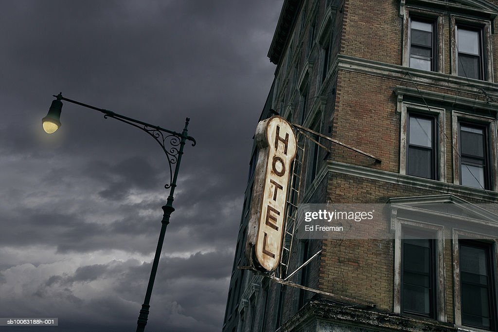 Sign on abandoned hotel, low angle view : Stock Photo