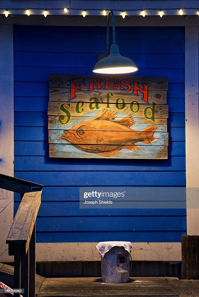 Sign on exterior of seafood restaurant