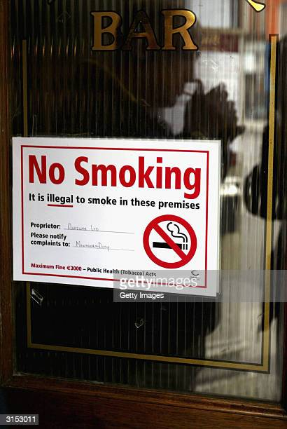 A sign on the door of a bar reads 'No Smoking' March 28 2004 on Parnell Street in Dublin Ireland became the first country in the world to outlaw...