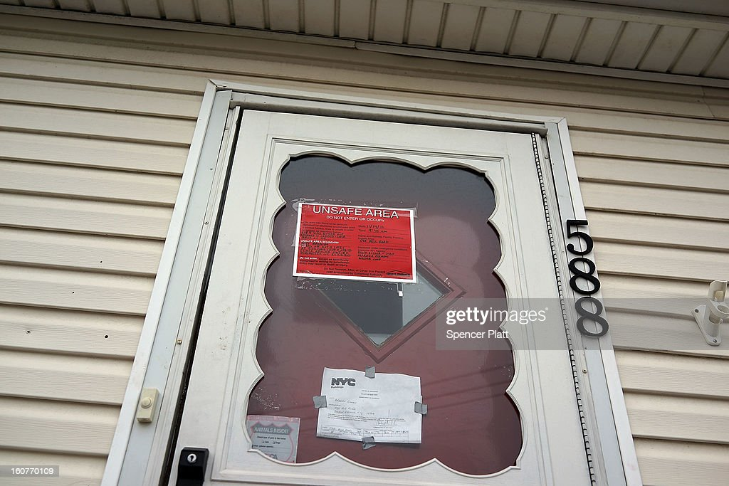 A sign on the door of a flood damaged home notifies that the area is unsafe in Oakwood Beach in Staten Island on February 5, 2013 in New York City. In a program proposed by New York Governor Andrew Cuomo, New York state could spend up to $400 million to buy out home owners whose properties were destroyed by Superstorm Sandy. The $50.5 billion disaster relief package, which was passed by Congress last month, would be used to fund the program. If the program is adopted, homeowners would be relocated and their land would be left as a natural barrier to help absorb future floods waters.
