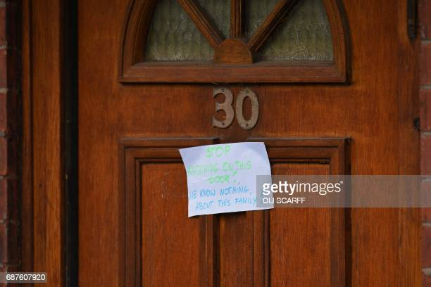 A sign on the front door of a house reads 'Stop Knocking On This Door We Know Nothing About This Family' is pictured on Elsmore Road in Fallowfield...