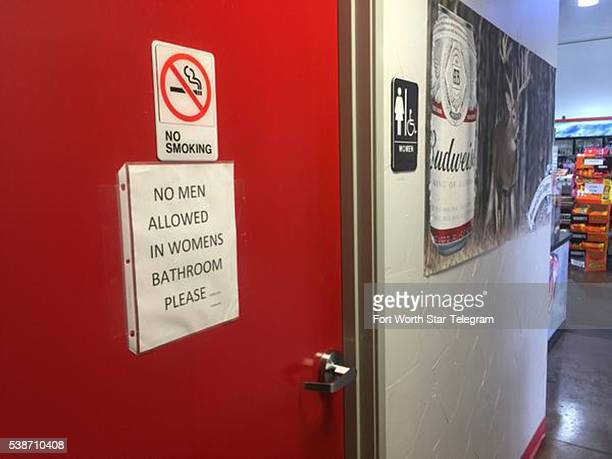 A sign on the women's bathroom door at the Texaco Station and BBQ on the Brazos restaurant seems to make clear the owner's stance on the transgender...