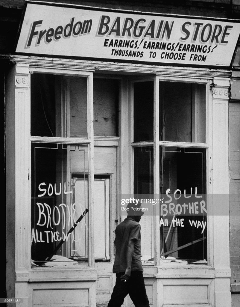 Sign on window of store during riots to show owner is African American