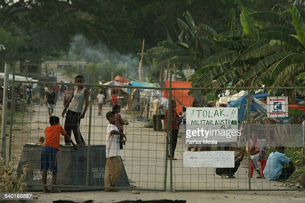 DARWIN A sign outside a Dili refugee camp warns Australian troops not to enter amid claims they repeatedly used violence to arrest people there...