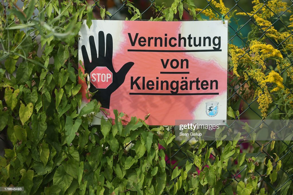 A sign outside a garden and cottage at the Oeynhausen Small Garden Association garden colony reads: 'Stop The Destruction Of Small Gardens' on August 29, 2013 in Berlin, Germany. At the Oeynhausen colony about 300 of its 438 gardens are currently threatened by real estate development, as are about another 24 colonies across the city. Berlin has about 900 garden colonies that are owned by the city and that provide urban dwellers who don't have land of their own the opportunity to maintain a garden and escape the stress of urban life. Berlin is currently undergoing a housing squeeze and city authorities are beginning to sell some of the colonies to developers, which has caused outrage in a city where the colonies of small gardens are a deep-seated tradition going back over a century.