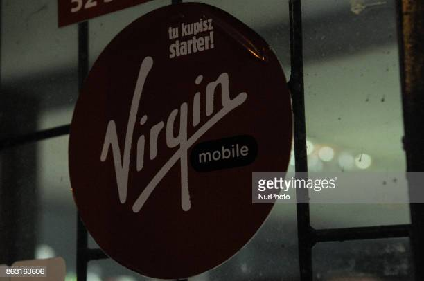 A sign outside a night shop advertising Virgin mobile is seen on 19 October 2017