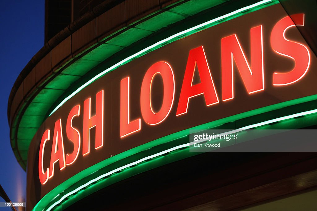 A sign outside a 'Speedy Cash' cash loans shop on Brixton High Street on November 1 2012 in London England The recession has changed the face of the...