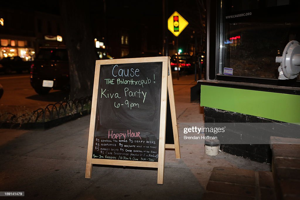 A sign outside advertises a launch event hosted by Capital One, Kiva, and the Latino Economic Development Center for Kiva City D.C. on January 8, 2013 in Washington, DC. Kiva City D.C. is a crowd-sourced micro-lending program for small businesses.