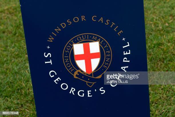 A sign outside St George's Chapel is pictured inside the grounds of Windsor Castle in Windsor west of London on December 8 2017 Britain's Prince...