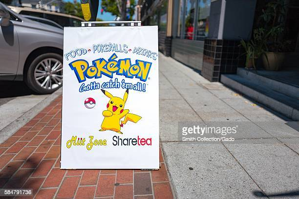 Sign outside the boba tea restaurant ShareTea advertising the restaurant as a popular place to play the augmented reality game Pokemon Go in the...