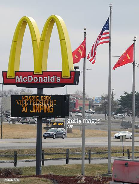 A sign outside the fastfood chain McDonald's in Muscatine Iowa welcomes Chinese Vice President Xi Jinping on February 15 2012 Xi who is expected to...