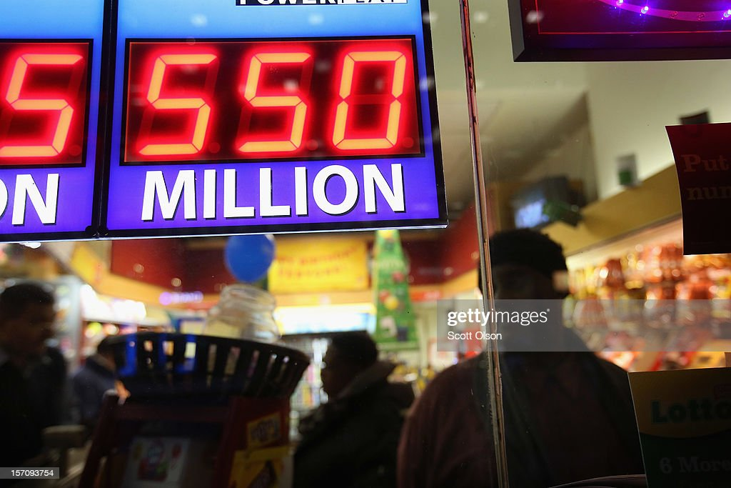 A sign outside the One Stop Mart shows the winning amounts for lottery games including the $550 million for the Powerball jackpot on November 28, 2012 in Chicago, Illinois. A single Powerball winner would get a lump sum payment of about $360.2 million before taxes.