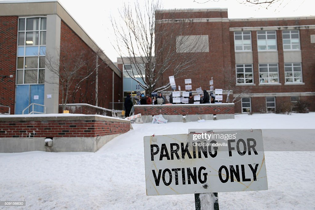 A sign outside the polling place at the Webster School tells voters where to park February 9, 2016 in Manchester, New Hampshire. Tuesday is the 100th anniversary of the New Hampshire primariy, the 'First in the Nation' test for presidential candidates from both parties.