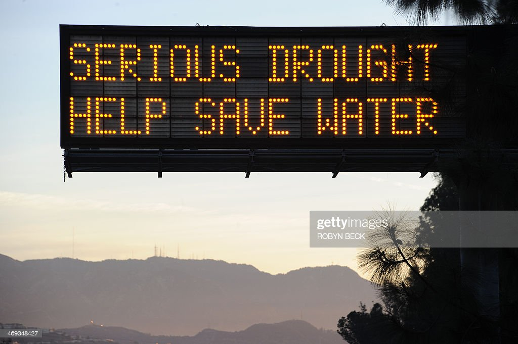 A sign over a highway in Glendale California warns motorists to save water in response to the state's severe drought February 14 2014 US President...