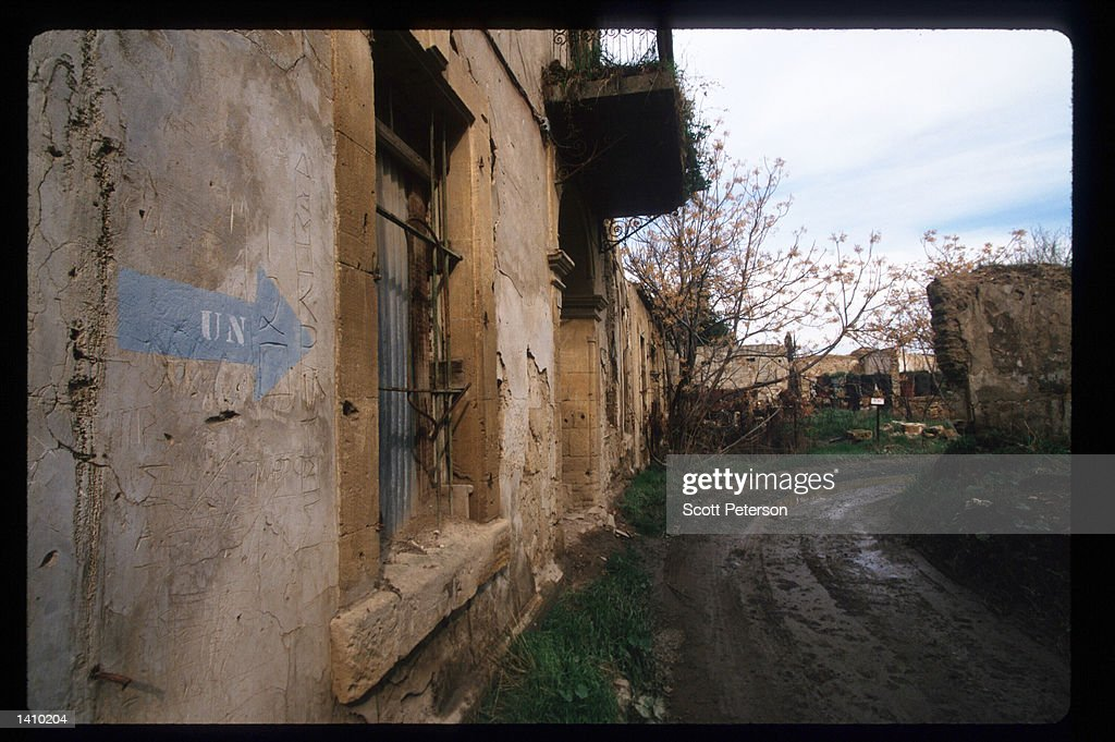 A sign pointing toward a UN station directs tour groups along the 'Green Line' January 6 1998 in Nicosia Cyprus Early in 1998 Cyprus will engage in...