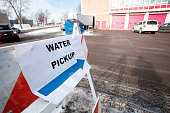 A sign points the ay for Flint residents to get bottled water water testing kits and water filters at a Flint Fire Station January 13 2016 in Flint...