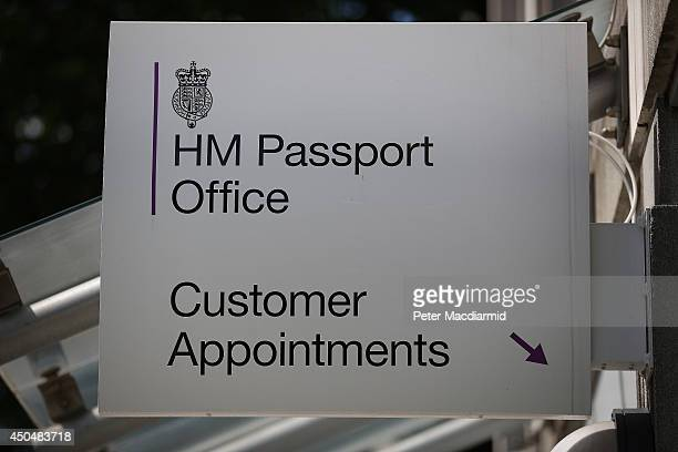 A sign points the way to the customer appointments entrance of the passport office on June 12 2014 in London England Home Secretary Theresa May has...