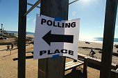 A sign points the way to the polling place at the lifeguard station in Manhattan Beach California November 4 2014 Americans trooped to the polls in...