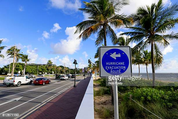 A sign points to an evacuation route as South Florida residents prepare for Hurricane Matthew on October 5 2016 in Fort Lauderdale Florida The...