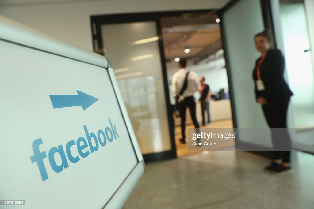 A sign points to the Berlin Facebook offices on the day German Interior Minister Thomas de Maiziere toured the facility and held talks with Facebook...