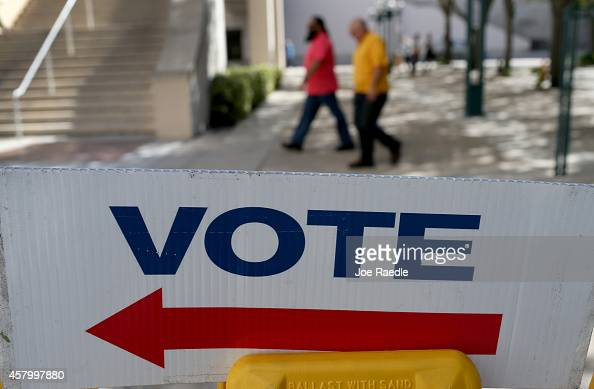 A sign points to the early voting station setup at the Government building on October 28 2014 in Miami Florida Florida's governor's race is being...