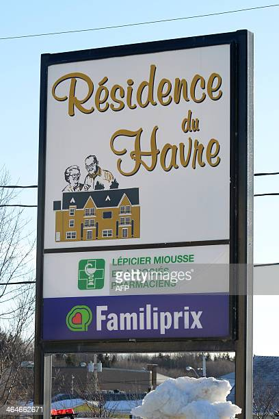A sign points to the retirement home 'Residence du Havre' a pharmacy and a grocery store in L'IsleVerte a small town 450 kilometers northeast of...