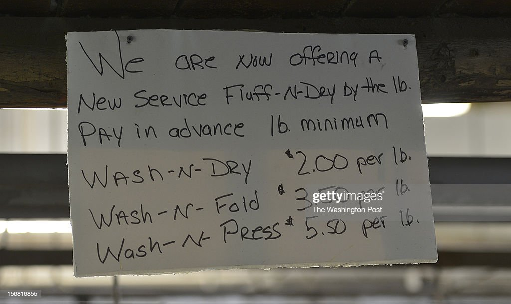 A sign posted, announcing the new Fluff-N-Dry service, hangs at the Dean Ave. Cleaners on November 20, 2012 in Washington, D.C. Willie Craft, 82, bought the cleaners in 1978 which has pretty much remained the same ever since. He's got a steady stream of return customers and folks who just drop by to visit. Willie's son, Willie Thomas Craft, Jr. also works there at the cleaners preparing to take over the business from his father when he retires.