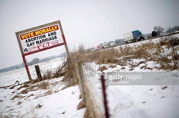 A sign posted on a farm just of I380 asks voters to vote morally against abortion and gay marriage outside of Waterloo Iowa January 25 ahead of the...