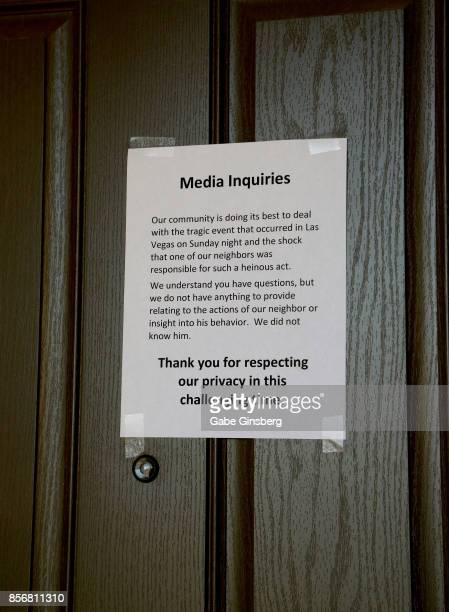 A sign posted on a neighbor's door next to the house where suspected Las Vegas gunman Stephen Paddock lived on October 2 2017 in Mesquite Nevada...