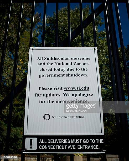 A sign posted on the gate of the National Zoo advises visitors that the institution is closed due to the partial government shutdown on October 15...