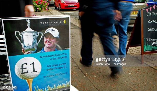 A sign promoting coffee on the high street of Rory McIlroy's home town of Holywood CoDown as he travels home later today
