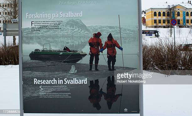 A sign promoting scientific research in the Svalbard region of Norway stands in front of a building where the Arctic Council has its offices in...