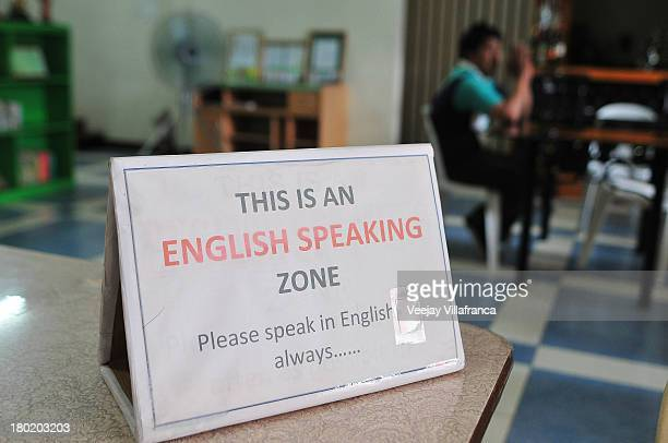 A sign promoting the use of the English language is seen in the World Class Company Unlimited on September 06 2013 in Manila Philippines Due to the...