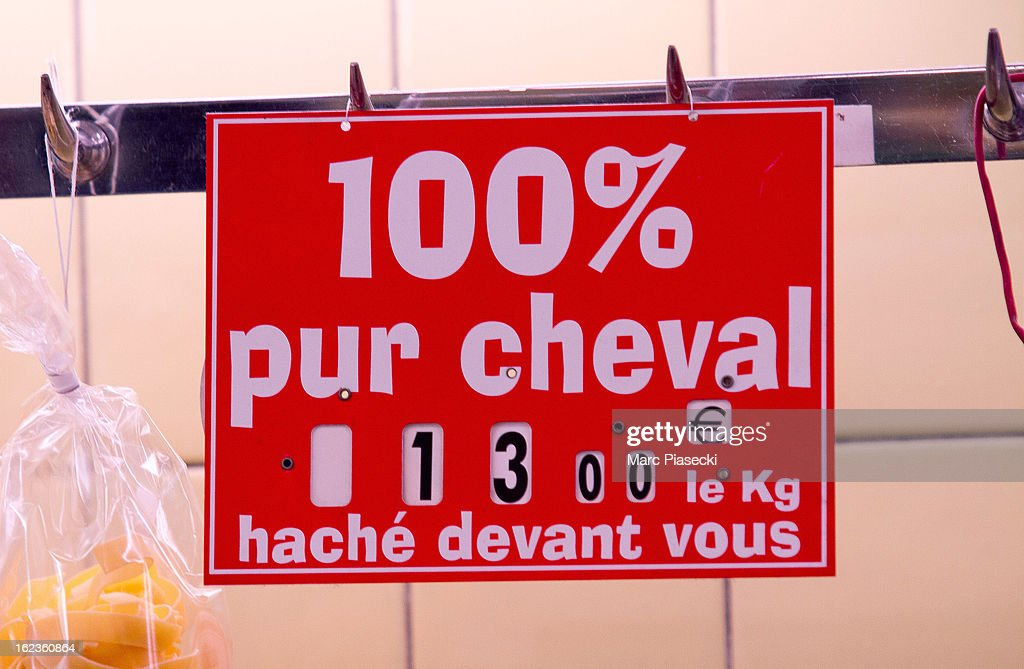 A sign reading '100% horsemeant' is seen in a 'boucherie chevaline' which is continuing to sell the meat despite the continued scandal across Europe...