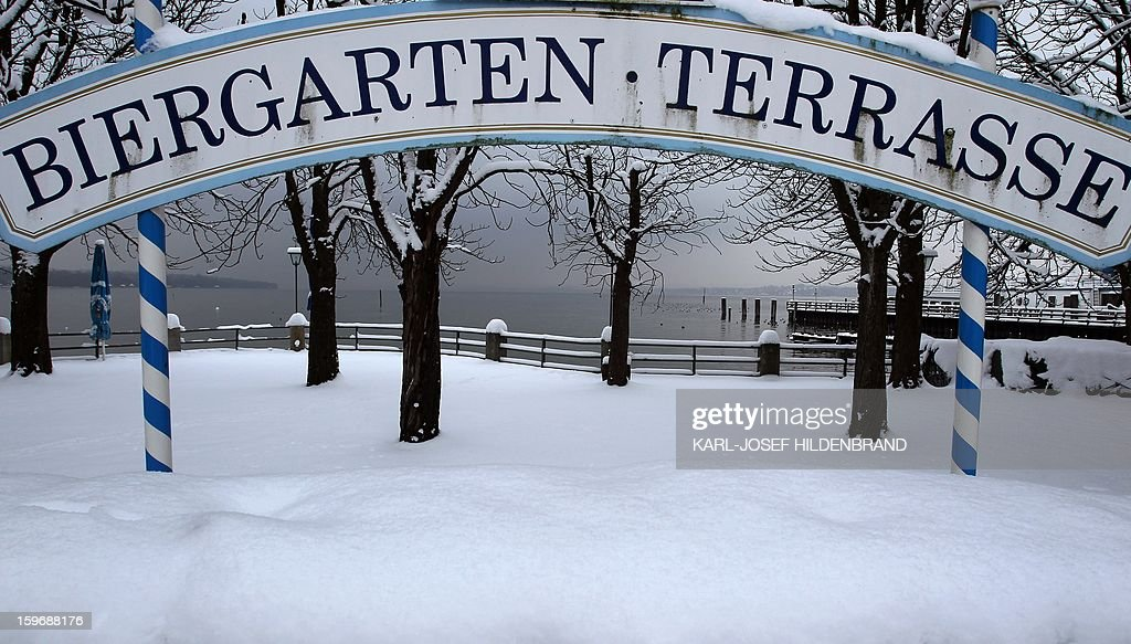 A sign reading 'Beer Garden Terrace' is seen after a snow fall on January 18, 2013 in Stegen, southern Germany.