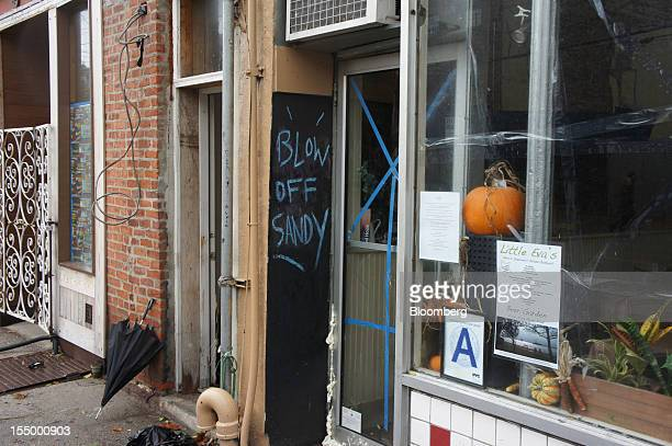 A sign reading 'Blow off Sandy' is seen in front of Kevin's Restaurant on Van Brunt Street in the Red Hook neighborhood of the Brooklyn borough New...