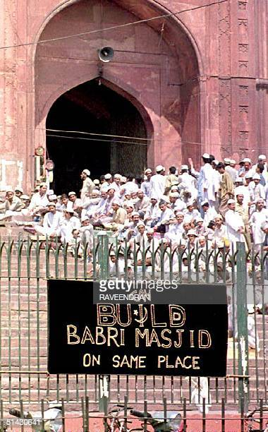 A sign reading 'Build the Babri Mosque on the Same Place' hangs before the massive Jamma Masjid 19 March 1993 in New Delhi The sign refers to the...
