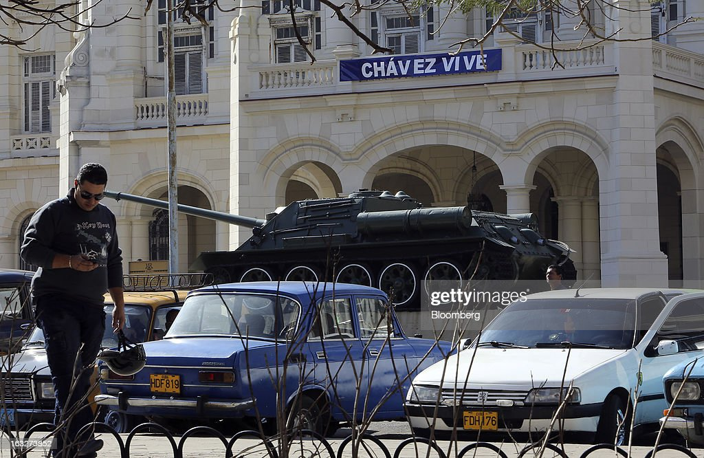 A sign reading 'Chavez Lives' is displayed on the Cuban Museum of the Revolution in Havana, Cuba on Wednesday, March 6, 2013. Cuba's government praised Venezuelan President Hugo Chavez following his death yesterday for uniting the people of Latin America and pledged loyalty to the continuation of his Bolivarian Revolution, according to the statement in the state-run Granma website. Photographer: Noah Friedman-Rudovsky/Bloomberg via Getty Images