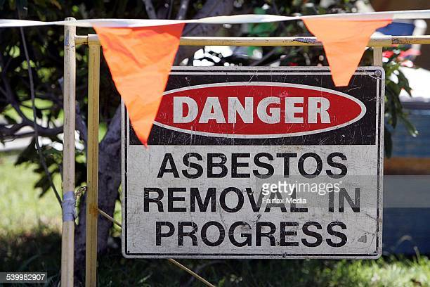 A sign reading 'Danger Asbestos removal in progress' outside a Kiama house 13 February 2006 ILW Picture by SYLVIA LIBER