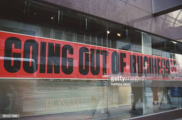 A sign reading 'Going Out Of Business' in the window of the Bonwit Teller department store after closure due to bankruptcy New York City USA April...