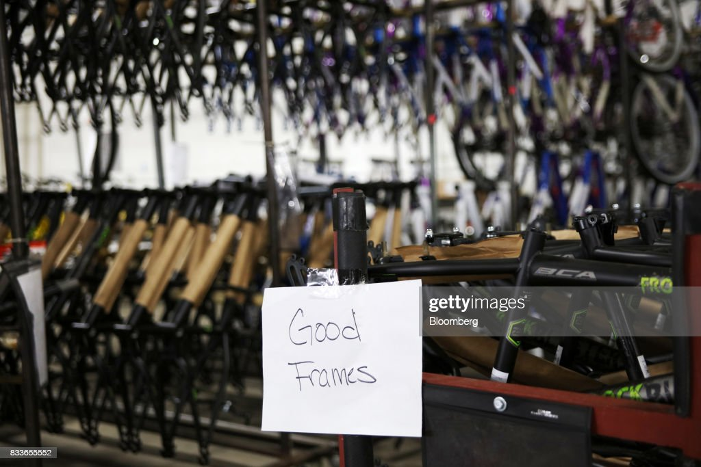 A sign reading 'good frames' hangs in front of painted bicycle frames at The Kent International Inc. Bicycle Corporation of America brand Assembly facility in Manning, South Carolina, U.S., on Sunday, June 25, 2017. Almost all of the roughly 18 million bicycles sold each year in the U.S. come from China and Taiwan. This year, about 130 workers at the Bicycle Corporation of America's new factory will assemble 350,000 bikes in the U.S. Photographer: Travis Dove/Bloomberg via Getty Images
