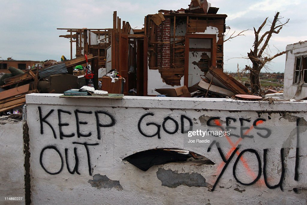 A sign reading, 'keep out God Sees You!' is seen on the wall in front of a home that was damaged when a massive tornado passed through the town killing at least 125 people on May 27, 2011 in Joplin, Missouri. The town continues the process of recovering from the storm.