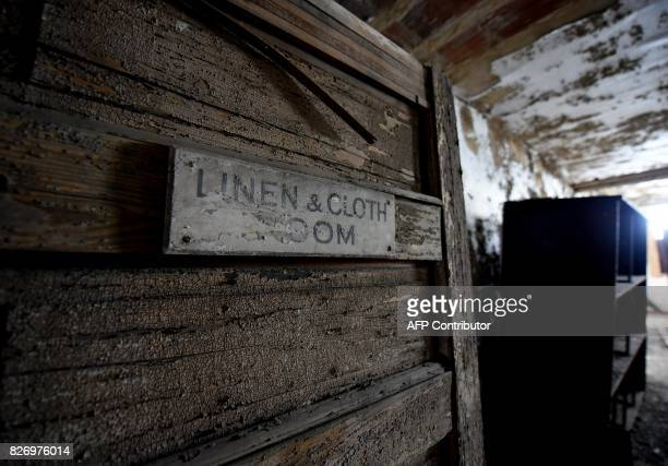 A sign reading 'linen and cloth room' is seen in one of the buildings of the The Ellis Island Hospital on August 5 a 750bed facility which treated...