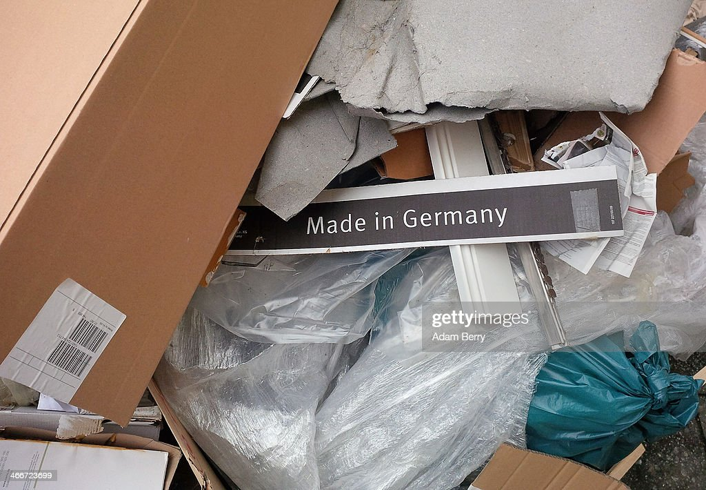 A sign reading 'Made In Germany' lies on a pile of trash on the sidewalk on February 3, 2014 in Berlin, Germany. Jacob Lew, the U.S. treasury secretary, criticized the importance of exports to Germany's economy at a press conference last month with German Finance Minister Wolfgang Schaeuble, his counterpart in the country.