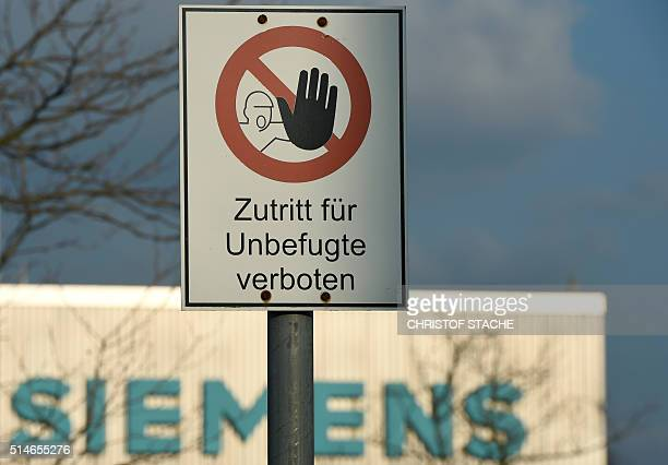 A sign reading 'No entry for unauthorized persons' stands in front of the Siemens factory in Nuremberg southern Germany on March 10 2016 German...