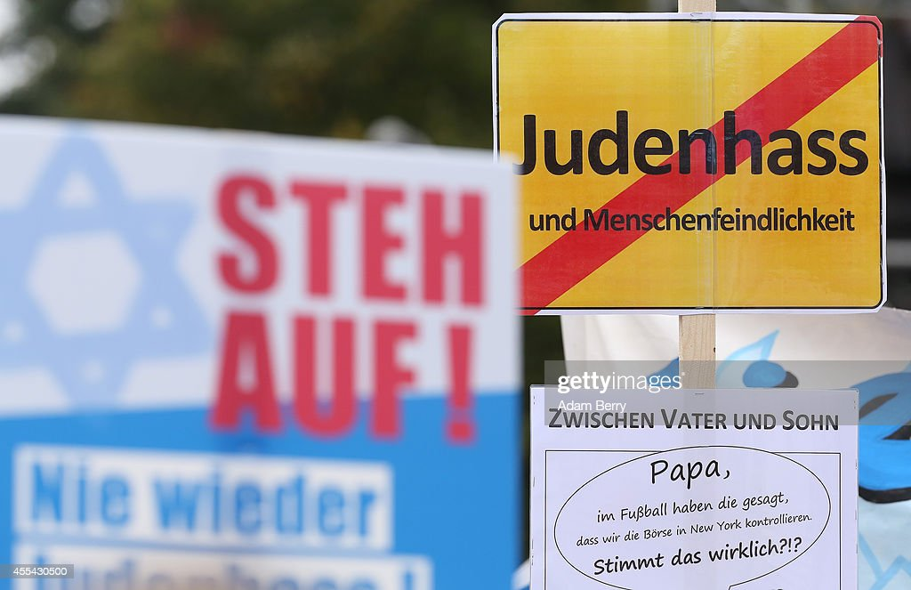 A sign reading 'No Hatred of Jews' in German is held up at a rally against antiSemitism on September 14 2014 in Berlin Germany With the slogan 'Stand...