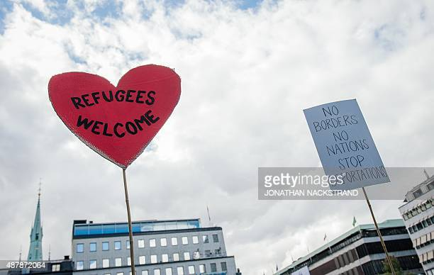 A sign reading 'refugees welcome' is pictured during a demonstration in solidarity with migrants seeking asylum in Europe after fleeing their home...