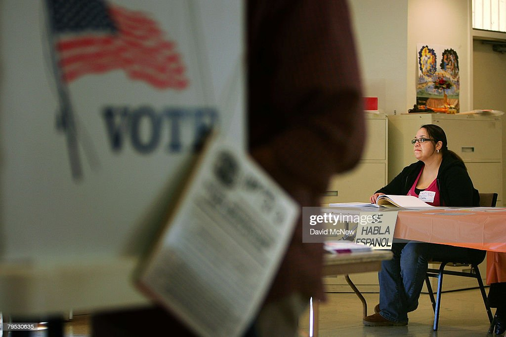 A sign reading 'Se habla Espanol' identifies a bilingual election official as voters go to the polls for Super Tuesday primaries in the predominantly...