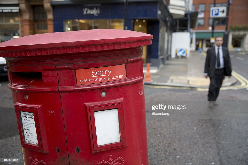 A sign reading 'Sorry: This post box is closed' covers a mail slot on a Royal Mail Group Ltd. double aperture pillar box in London, U.K., on Friday, Sept. 13, 2013. Royal Mail Group Ltd., the U.K.'s 360-year-old postal service, intends to hold an initial public offering of a majority stake 'in the coming weeks' to help the company gain a competitive edge against European rivals. Photographer: Simon Dawson/Bloomberg via Getty Images
