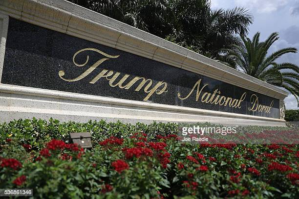 A sign reading Trump National Doral is seen on the grounds of the golf course owned by Republican presidential candidate Donald Trump on June 1 2016...